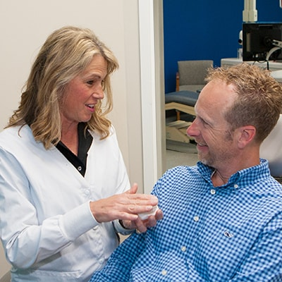 Dental Services Fishers, IN - Dr. Holt discussing the possibility of porcelain veneers with a patient